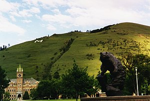 Campus of the University of Montana - University of Montana campus, showing Mount Sentinel with the M Logo, the Grizzly mascot, and University (Main) Hall.