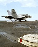 VFA-147 FA-18C Hornet catching arresting wire on USS Nimitz (CVN-68) 971106-N-6939M-269.jpg
