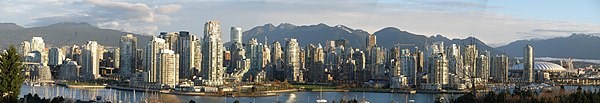 Vancouver, BC viewed from the south with mountains behind.