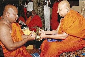 Mahanayaka - Most Ven. Thibbatuwawe Sri Siddhartha Sumangala Maha Nayaka thera presenting an honorary title to a Buddhist monk
