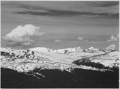 "View at timberline, dark foreground, light snow capped mountain, gray sky, ""Rocky Mountain National Park. Never Summer R - NARA - 519960.tif"