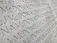 names inscribed on outside wall of Vimy monument more clearly visible after restoration