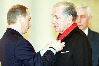 Georgiy Zhzhonov - President Vladimir Putin, himself a former KGB spy, decorating Georgiy Zhzhonov for his artistic portrayals of Soviet secret agents.