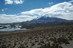 Parinacota (volcano) - View on the sector collapse deposit. In the background Pomerape, on the left the Cotacotani lakes