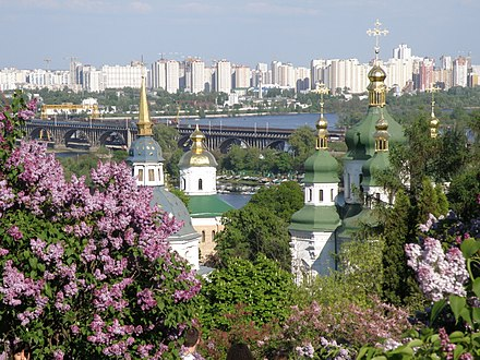 Lilacs in the National Botanical Garden, with the Vydubychi Monastery, Darnitskiy Rail Bridge and left-bank Kiev visible in the background Vydubychi Monastery 2008(Kiev).JPG