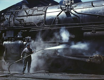 "Steam-cleaning the running gear of an ""H"" class locomotive, Chicago and North Western Railway, 1943 Washing loco.jpg"