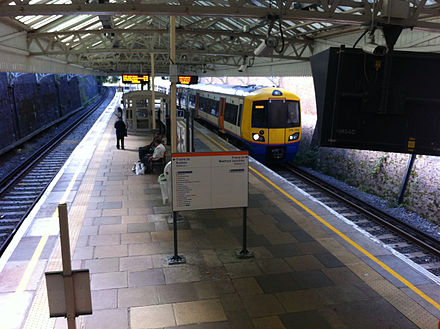 A London Overground train arriving at Watford High Street Watford High Street Overground train.jpg