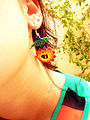 We love the sun , huichol beaded earring.jpg
