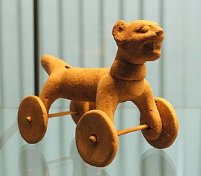 A toy animal with wheels