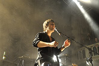 White Lies (band) - Harry McVeigh performing in 2009