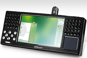 "Ultra-mobile PC - The Wibrain B1 UMPC was a UMPC based on the VIA Ultra Mobility Platform featuring a 1.2 GHz VIA C7-M processor, 4.8"" touchscreen, split thumb keyboard, touchpad, and webcam."