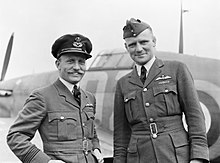 Wing Commander F V Beamish (right), the Station Commander of North Weald, Essex, standing with Squadron Leader E M Donaldson, Commanding Officer of No. 151 Squadron, following a successful combat with enemy fig CH490.jpg