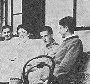 Hochreit 1920. Wittgenstein is seated between his sister Helene Salzer and his friend, Arvid Sjögren.
