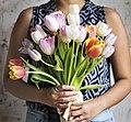 Woman holding a bouquet of tulips (Rawpixel.com 2017-04-27 Unsplash pgi0LPOM FI).jpg