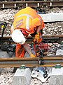 Work on the railway line - fitting a fishplate - geograph.org.uk - 1754300.jpg