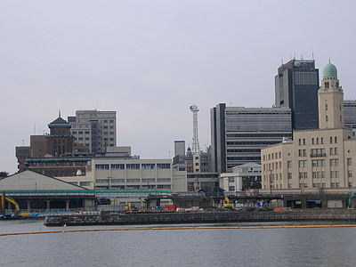 three building along a waterfront