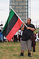Young man from Detroit waving the Black Liberation Flag at the Washington Monument - 50th Anniversary of the March on Washington for Jobs and Freedom.jpg
