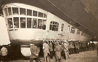 LZ 127 Graf Zeppelin - Many people were needed to hold down the D-LZ127. The ram air turbine electric generator is just under the radio room window.