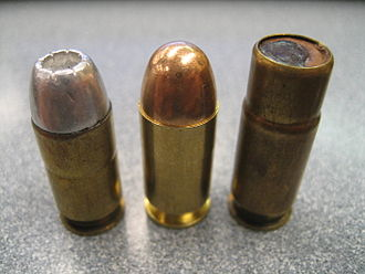 "Shotgun shell - Military Issue .45 ACP M15 ""shot shell"" on the far right."