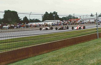 1991 Indianapolis 500 - Front row during the pace laps. Outside (Mario Andretti), middle (A. J. Foyt), inside (Rick Mears)