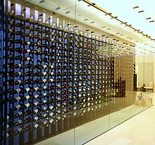 floor to ceiling wine racks behind glass case