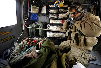 United States Air Force Pararescue - A pararescueman from the 66th Expeditionary Rescue Squadron provides medical attention to a wounded Afghan.