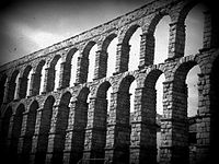 A Black and White Photo of the Aqueduct of Segovia in Spain.jpeg