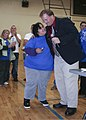 A Special Olympics athlete, left, hugs Richard Cole, the Marine Corps Community Services New River director, after receiving her award during the 2011 Onslow County fall games Dec 111202-M-JO751-235.jpg
