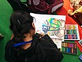 A child participating in the painting competition on the theme- Clean India Healthy India of the Health Pavilion, at the India International Trade Fair, 2014, at Pragati Maidan, in New Delhi on November 23, 2014.jpg