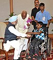 A handicapped child tying 'Rakhi' to the Prime Minister, Dr. Manmohan Singh, on the occasion of 'Raksha Bandhan', in New Delhi on August 24, 2010.jpg