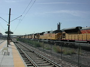 E Line (RTD) - E Line at 10th/Osage by a UP rail yard