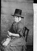 A woman in national dress and knitting (Davies) NLW3362583.jpg