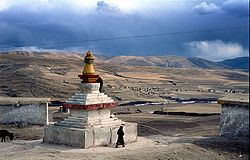 Buddhist stupa and houses outside the town of Ngawa Town, Sichuan, China.