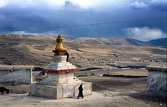 Tibetan Plateau - Tibetan Buddhist stupa and houses outside the town of Ngawa, on the Tibetan Plateau.