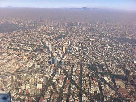 Air pollution over Mexico City in December 2010. Air quality is poorest during the winter. AerialViewMexicoCity.jpg