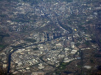 Salford Quays - Aerial photograph showing Salford Quays with Manchester (top) and Trafford (bottom)