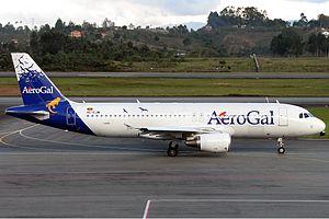 Avianca Ecuador - An AeroGal Airbus A320 landing at Jose Maria Cordova International Airport