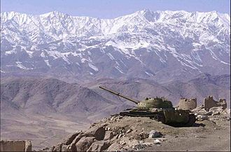 Hindu Kush - Landscape of Afghanistan with a T-62 in the foreground.
