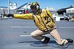 Airman sculpture on the flight deck of the USS Midway.jpg