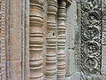 Angkor - Ta Prohm - 029 False Window and Medallions (8580864823).jpg