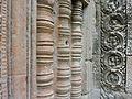 Angkor - Ta Prohm - 029 False Window and Medallions (8580864823).jpg