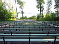 Apgar Amphitheater - 3 (Dont worry, there is a beautiful view of Lake McDonald behind the stage. The position of the sun in this photo just makes it look washed out.) (7637363510).jpg