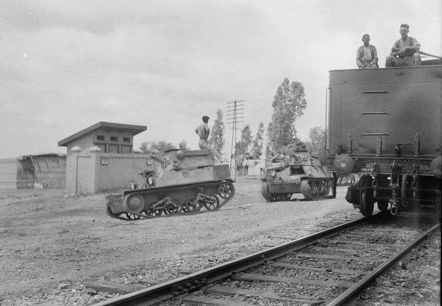 Armoured tanks escorting trains