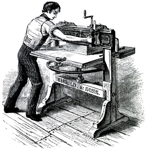 Cross-hatched image of a man working at a large bench, holding an attached tool against a clamped book.