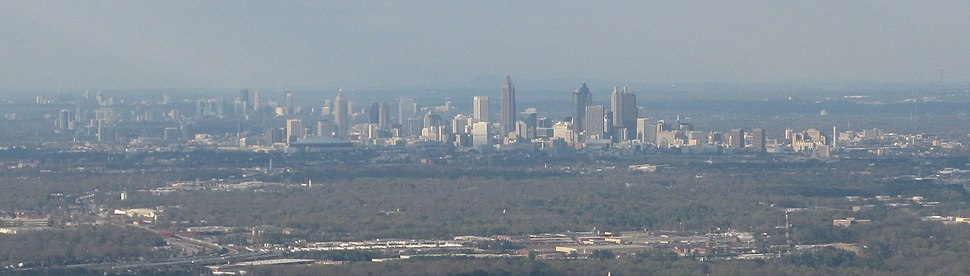 The skylines of Downtown, Midtown, Buckhead (all within the city of Atlanta), and Perimeter Center viewed from the southwest near Hartsfield–Jackson Atlanta International Airport.