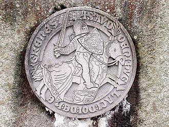 Audunborg - Audun Hugleiksson's seal on the memorial erected on the former castle site.