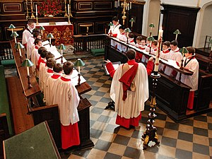 Anglican church music - A parish church choir at All Saints' Church, Northampton; singers wear traditional cassock, surplice and ruff and stand in facing rows of Decani and Cantoris in the choir stalls