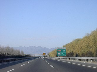Transport in Beijing - The Badaling Expressway near the intersection with the Northern 6th Ring Road (taken in November 2002)