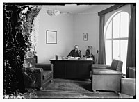 Barclay's Mr. Clarks, Director, at his desk LOC matpc.10349.jpg