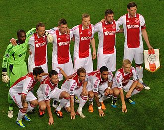 AFC Ajax - 2011 AFC Ajax team wearing their home kit by adidas with the AEGON sponsor across the chest, ahead of their UEFA Champions League match against Olympique Lyonnais.
